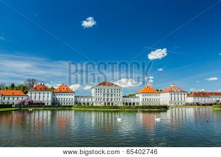 MUNICH, GERMANY - MAY 8, 2012: Swans in artificial pool in front of the Nymphenburg Palace. Munich, Bavaria, Germany