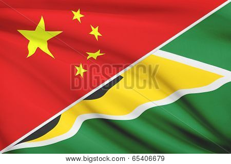 Series Of Ruffled Flags. China And Co-operative Republic Of Guyana.