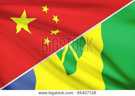 Series Of Ruffled Flags. China And Saint Vincent And The Grenadines.