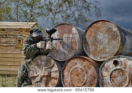 Paintball Player Aiming At His Rival