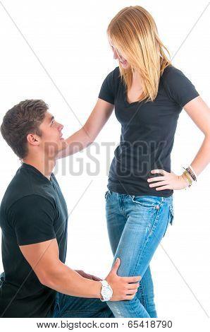Young Man Kneeling To Propose