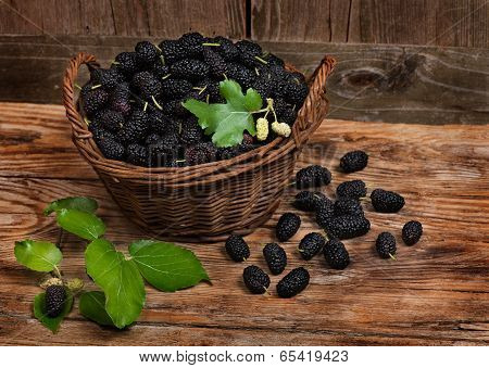 Mulberries With Leaves On A Wicker Basket
