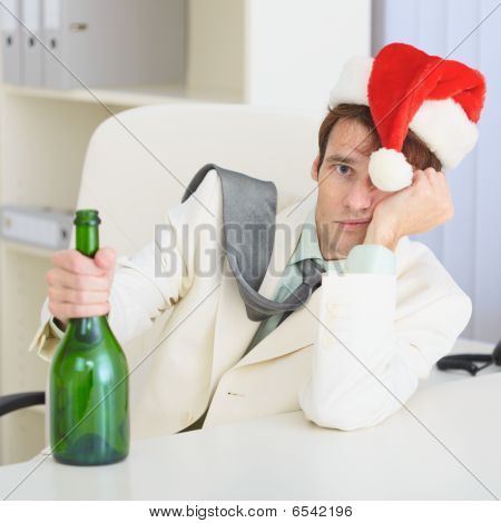 Young Drunkard Celebrates Christmas With Wine Bottle