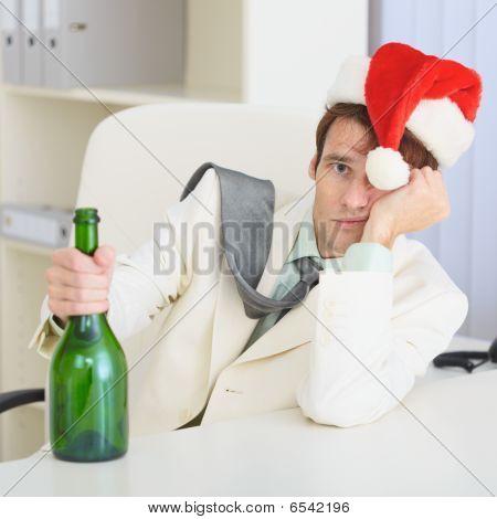 Young Drunkard Celebrates Christmas With Wine Bottle