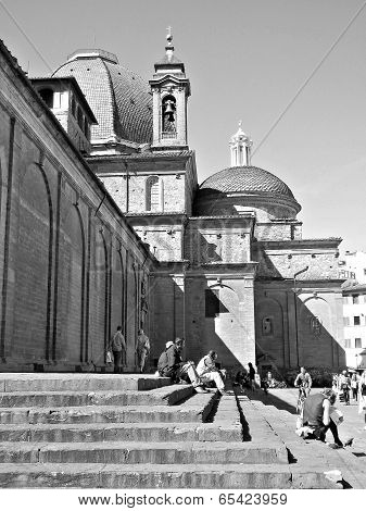 People Relaxing On The Stairs In Florence