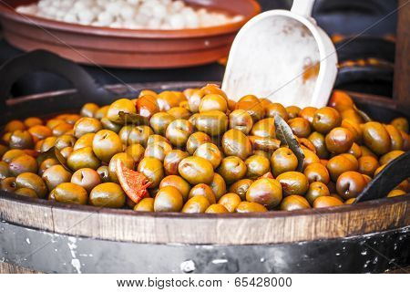 Nutrition, Wooden drums with olives and variants
