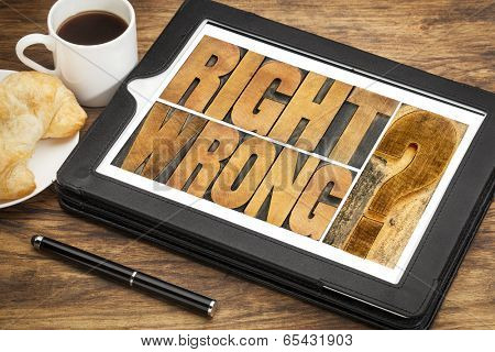 right or wrong ethical choice  dilemma - word abstract in wood letterpress printing blocks on a digital tablet