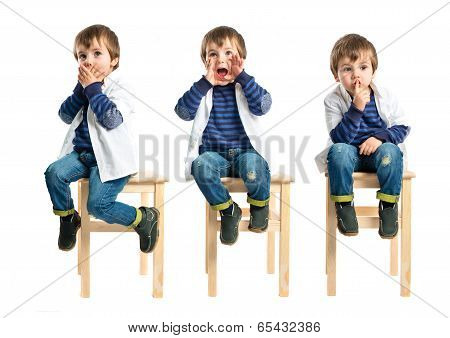 Kid Shouting And Doing Silence Gesture Over White Background
