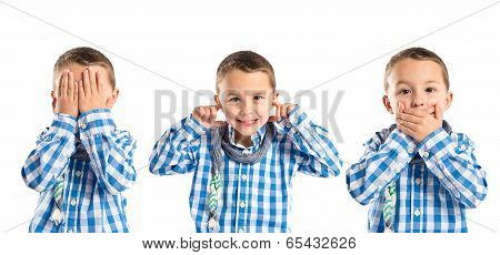 Kid Covering His Mouth, His Ears, And His Eyes