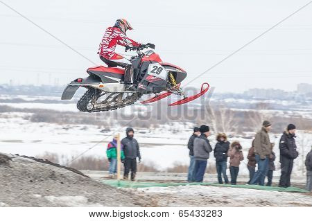 Sportsman jump on snowmobile