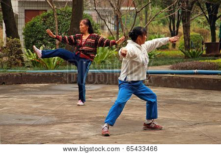 Guilin, China - Nov 4, 2007: Chinese Women Doing Tai Chi In The Park. Tai Chi, Wushu And Other Healt