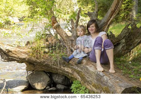 Mother With Her Toddler Baby In The Nature