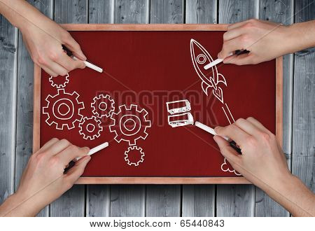 Composite image of multiple hands drawing doodles with chalk on wooden board