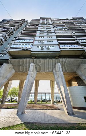 MOSCOW, RUSSIA - MAY 8, 2014: House on chicken legs. This 25-storey residential building is built on concrete piers in 1968.