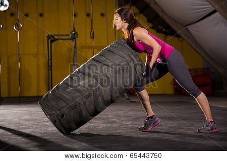 Cute Girl Flipping A Tire