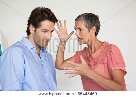 Angry businesswoman shouting at employee in the office