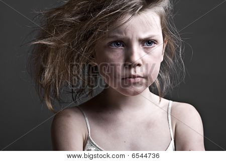 Messy Child Against A Grey Background