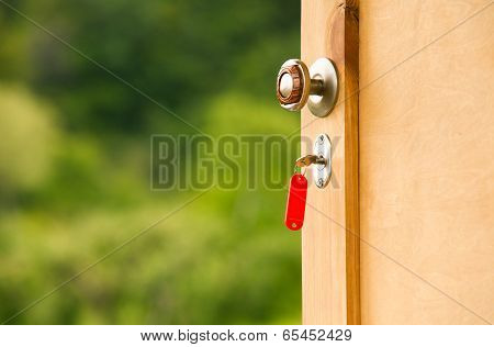 Key in keyhole of country house