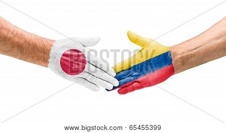 Handshake Japan and Colombia on a white background