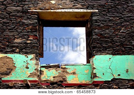 Old Wall Of House  Ruins  And Window Against Sky