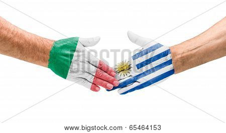 Handshake Italy and Uruguay on a white background