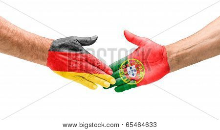 Handshake Germany and Portugal on a white background