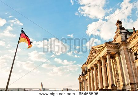 German Parliament with national flag in Berlin, Germany