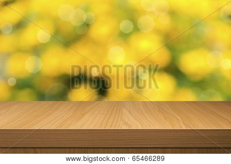 Foliage Bokeh Background  With Empty Wooden Table.