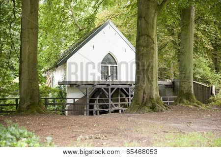 Watermill With Bladewheel In Forest