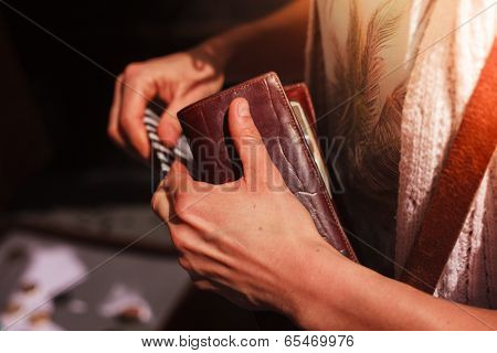 Woman Holding Her Wallet Outdoors