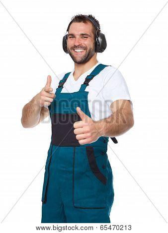 Portrait Of Smiling Worker In Blue Uniform With Protective Earphones