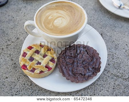 Cup Of Coffee And Wo Tarts On A Plate