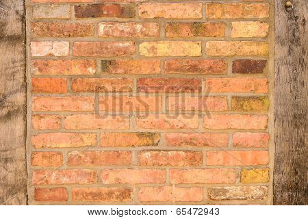Old Brick Wall Texture With Wooden Uprights