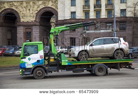 Moscow, Russia - March 22 2014: Evacuation Vehicles Carries Evacuated Car On The Street Of The City.