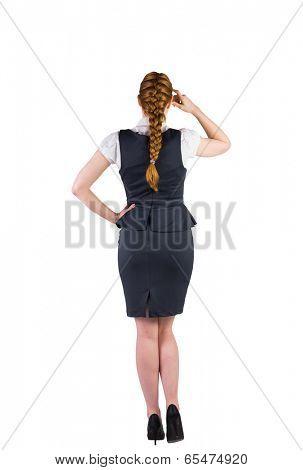 Redhead businesswoman scratching her head on white background