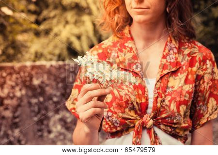 Young Woman Holding A Bunch Of Elderflowers