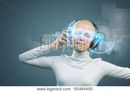 Young woman in white wearing headphones against media background