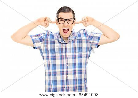 Nervous man plugging his ears isolated on white background