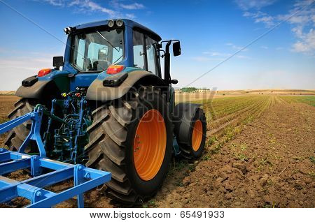 Huge tractor in the field - In a nice blue sunny day