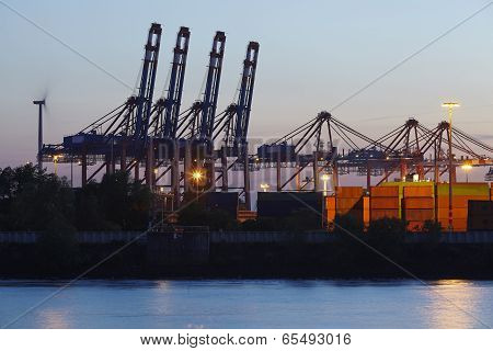 Hamburg - Container Gantry Cranes In The Evening