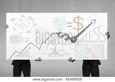 Men Holding Board With Business Doodles And Clock Hands