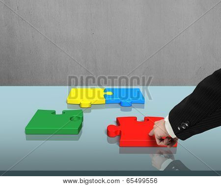 Assembling Puzzles On Table
