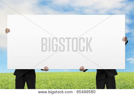 Two Men Lifting Blank Board Outdoor
