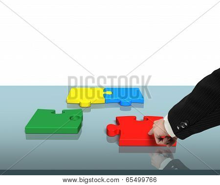 Assembling Four Puzzles On Table