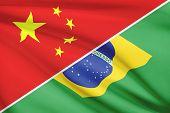 stock photo of brazilian money  - Flags of China and Federative Republic of Brazil blowing in the wind - JPG