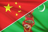 picture of turkmenistan  - Flags of China and Turkmenistan blowing in the wind - JPG
