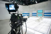 image of studio  - Television studio with jib camera and lights  - JPG