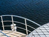 stock photo of pontoon boat  - Pontoon in boat harbor on deep blue water background - JPG
