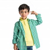 foto of sarcasm  - Kid making a crazy gesture over white background - JPG