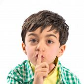 picture of shh  - Kid doing silence gesture over white background - JPG